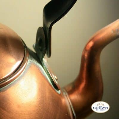 How to remove limescale: Brass kettle with signs of limescale and burnt stains
